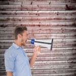 Man shouting through megaphone — Stock Photo #69032771