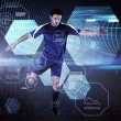 Composite image of football player in blue kicking — Stock Photo #69033339