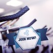 Join now against row of exercise bikes — Stock Photo #69035677