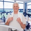 Senior man on the treadmill — Stock Photo #69037615