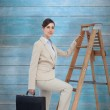 Businesswoman climbing career ladder with briefcase — ストック写真 #69039273