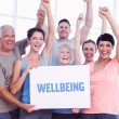 Wellbeing against portrait of happy fit people — Stock Photo #69039857