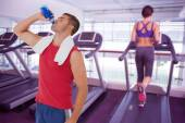 Fit man drinking water from bottle — Stock Photo
