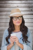Brunette with disposable cup — Stock Photo