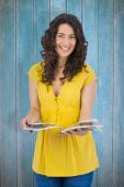 Curly haired brunette reading magazine — Stock Photo