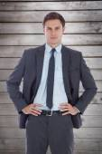 Businessman with hands on hips — Stock Photo