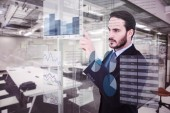 Focused businessman pointing in suit jacket — Stock Photo