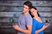Young couple sending a text — Stock Photo