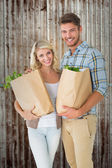 Couple holding their grocery bags — Stock Photo