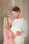 Attractive couple flashing their cash — Stock Photo