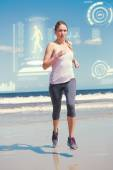 Focused fit blonde jogging on the beach — Stock Photo