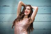 Glamorous brunette against wooden planks — Stock Photo