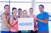 Members against portrait of a group of fitness class holding bla — Stock Photo