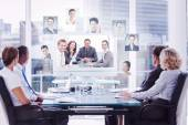 Group of business people looking at a screen — Stock Photo
