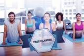 Word free classes and fit class doing the cobra pose — Stock Photo