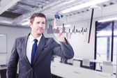Focused businessman pointing with finger — Stock Photo