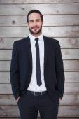 Businessman standing with hands in pockets — Stock Photo