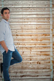 Unsmiling casual man standing — Stock Photo