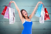Woman holding up shopping bags — Stock Photo