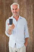 Man showing smartphone to camera — Stock Photo