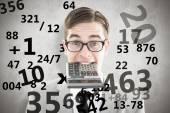 Geeky smiling businessman biting calculator — Stock Photo
