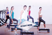 Word start now and fitness class performing step aerobics — Stock Photo