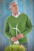 Man thinking about wind turbines — Stock Photo