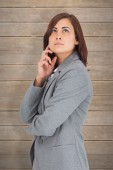 Concentrating businesswoman against wooden planks — Stock Photo