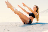 Fit blonde in core balance pilates pose — Stock Photo
