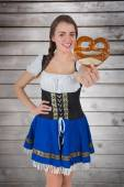 Oktoberfest girl holding pretzel — Stock Photo