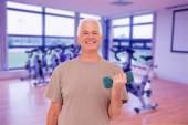 Senior man lifting hand weights — Stock Photo