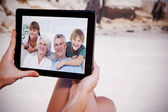 Grandchildren and grandparents sitting on couch — Stock Photo