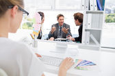 Charismatic chairman talking with his team — Stock Photo