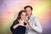 Couple forming heart with hands — Stock Photo