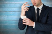 Handsome businessman adjusting his cuffs — Stock Photo