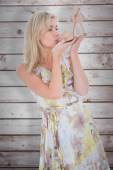 Elegant blonde admiring a shoe — Stock Photo