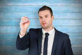 Businessman writing with marker — Stock Photo