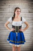 Oktoberfest girl with hands on hips — Stock Photo