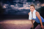 Fit woman with towel on shoulders — Stock Photo