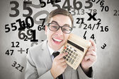 Geeky smiling businessman showing calculator — Stock Photo