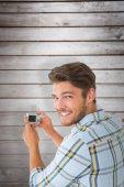 Man taking photo and smiling — Stock Photo