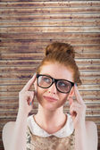 Hipster redhead looking up thinking — Stock Photo