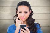 Pretty brunette sending a text — Stock Photo