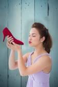 Elegant brunette kissing a shoe — Stock Photo