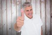 Man showing thumbs up at camera — Stock Photo