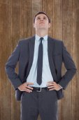 Serious businessman with hands on hips — Stock Photo