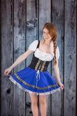 Oktoberfest girl spreading her skirt — Stock Photo