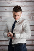 Handsome businessman checking the time — Stock Photo