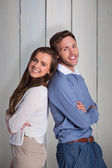 Happy couple back to back — Stock Photo