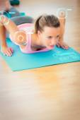 Determined beautiful woman doing push ups — Stok fotoğraf